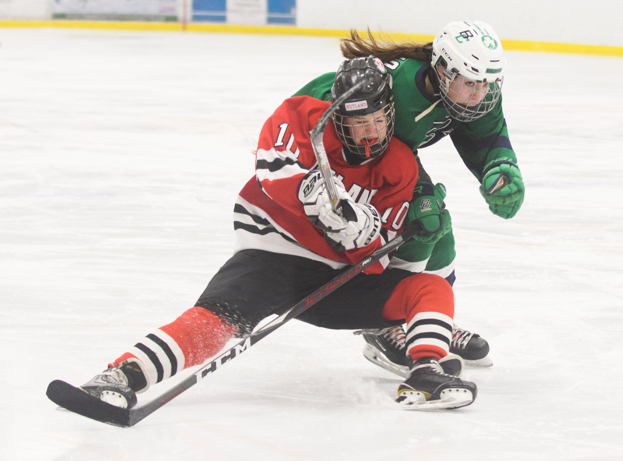 Rutland's Elise Lidmore (10) falls down as she and Burlington/Colchester's Madison Chagnon (4) chase down the puck during the girls hockey game between the Rutland Raiders and the Burlington/Colchester Sea Lakers at the Gordon Paquette Arena at Leddy Park on Tuesday afternoon March 5, 2019 in Burlington, Vermont.
