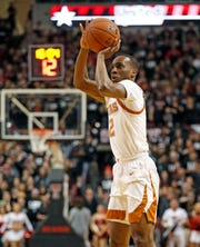 Texas' Matt Coleman III (2) shoots during the first half of an NCAA college basketball game against Texas Tech, Monday, March 4, 2019, in Lubbock, Texas. (AP Photo/Brad Tollefson)