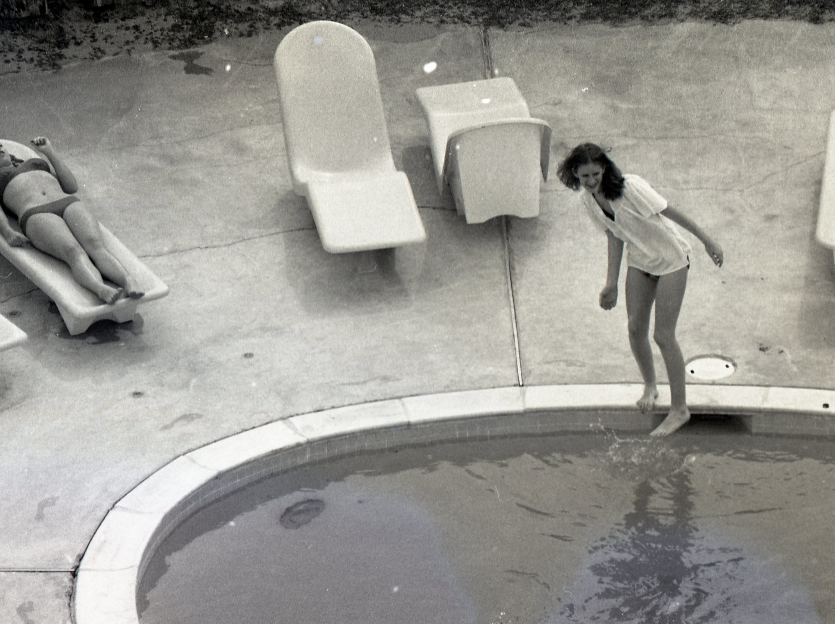 Testing the pool waters during spring break on Padre Island on March 17, 1979.