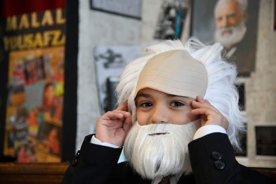 """Seven-year-old Tristen Gomez dresses up as Alexander Graham Bell for the Live Museum at Windsor Park Elementary School, Tuesday, March 5, 2019. Gomez chose the inventor because he is also interested in technology and likes """"how his has creativity to make something electronic."""""""