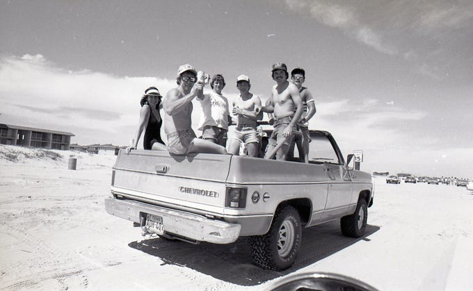 Spring breakers on Padre Island toast the Caller-Times photographer on March 18, 1978.