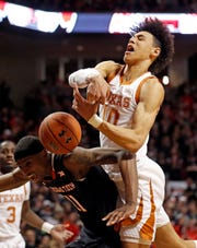 Texas' Jaxson Hayes (10) tries to rebound the ball over Texas Tech's Tariq Owens (11) during the first half of an NCAA college basketball game Monday, March 4, 2019, in Lubbock, Texas. (AP Photo/Brad Tollefson)