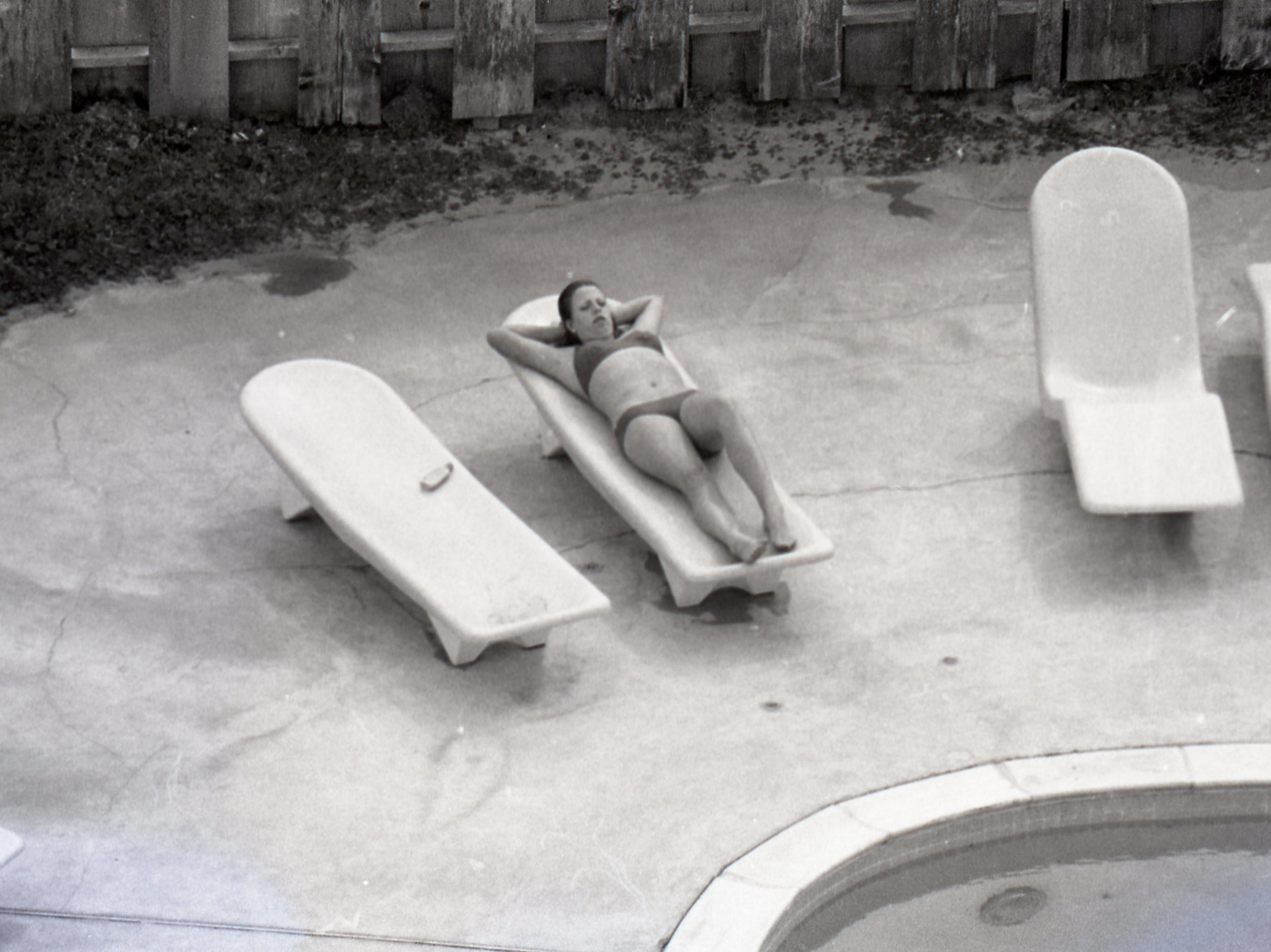 A spring breaker lounges beside an unidentified pool on Padre Island on March 17, 1979.