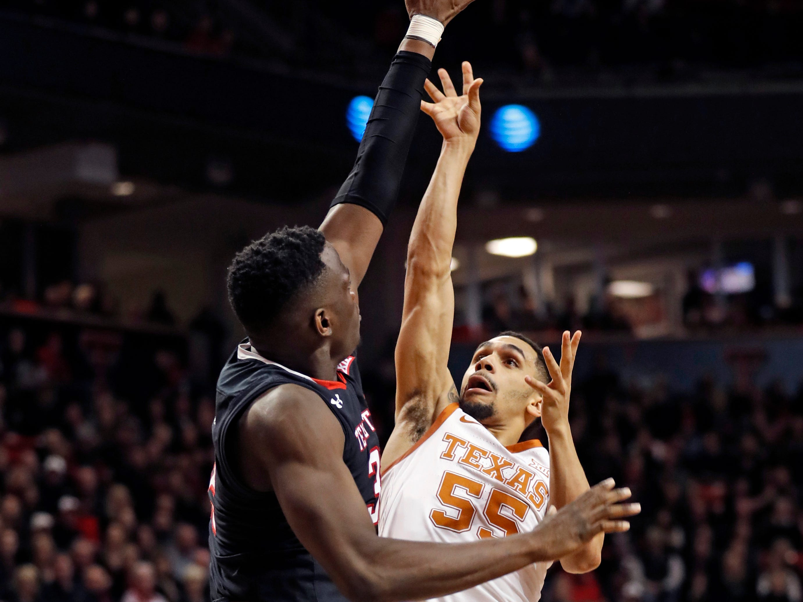 Texas Tech's Norense Odiase (32) tries to block the shot by Texas' Elijah Mitrou-Long (55) during the second half of an NCAA college basketball game, Monday, March 4, 2019, in Lubbock, Texas. (AP Photo/Brad Tollefson)