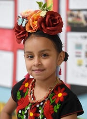 Kianna Peña, 7, dresses up as Frida Kahlo at the Live Museum at Windsor Park Elementary School, Tuesday, March 5, 2019. Peña likes painting and wants to be an artist like Kahlo when she grows up.