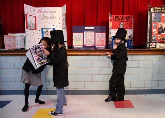 Various Abraham Lincolns show their historical figure reports to other students at the Live Museum at Windsor Park Elementary School, Tuesday, March 5, 2019. The students chose their historical figures.