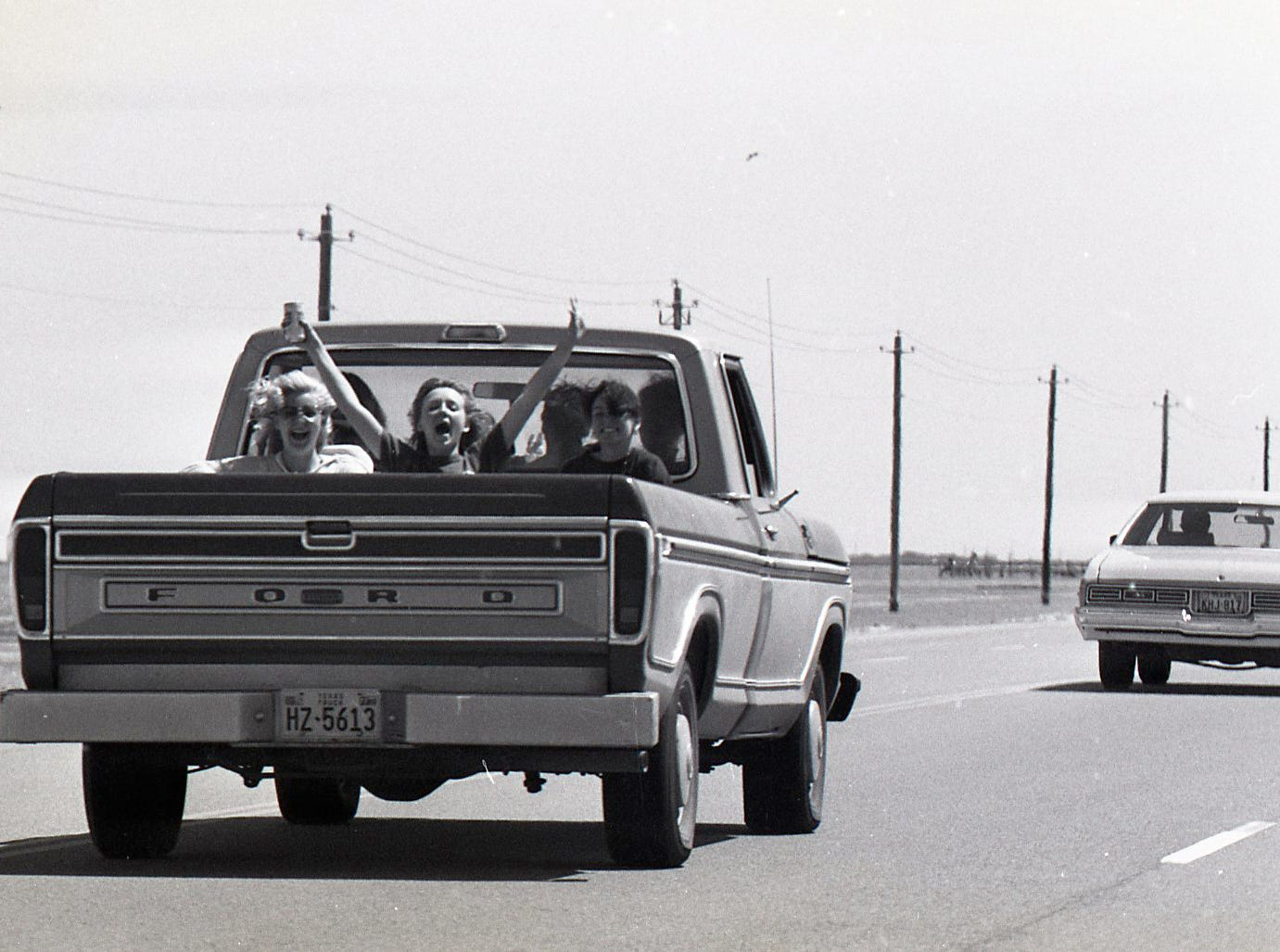 These kids were excited for spring break as they drive along the JFK Causeway on March 18, 1978.