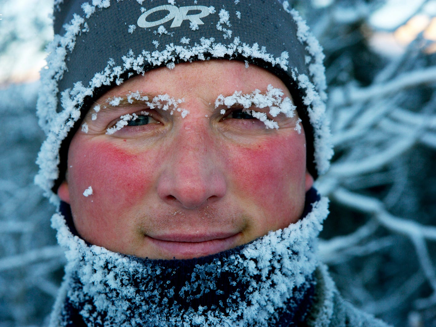 Frost crystals and rosy cheeks on a young man's face. The exhibition is organized and traveled by the National Geographic Society
