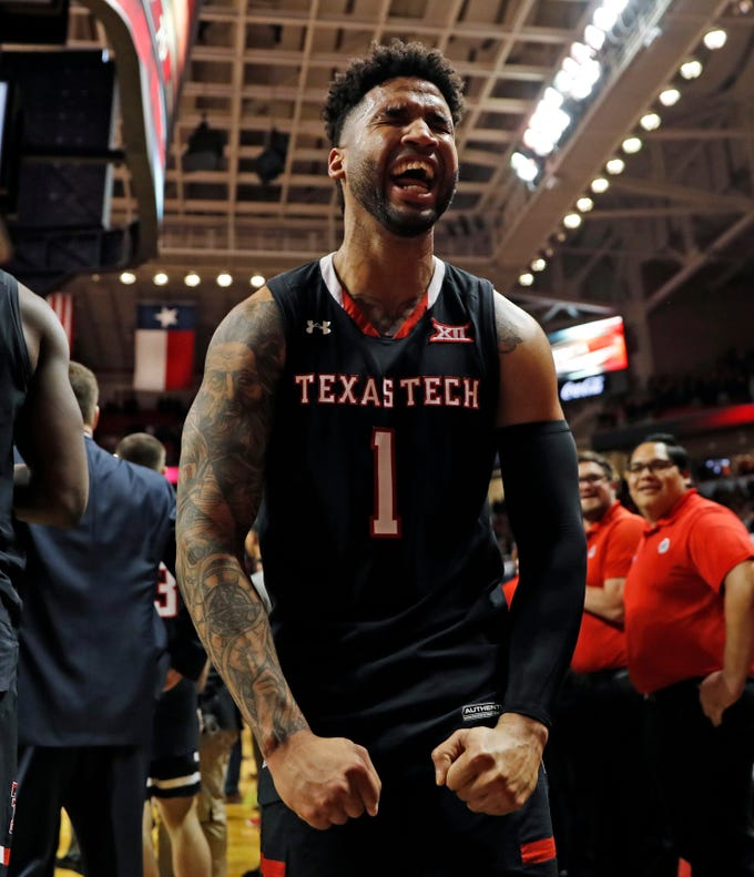 Texas Tech's Brandone Francis (1) celebrates with the fans after an NCAA college basketball game against Texas, Monday, March 4, 2019, in Lubbock, Texas. (AP Photo/Brad Tollefson)