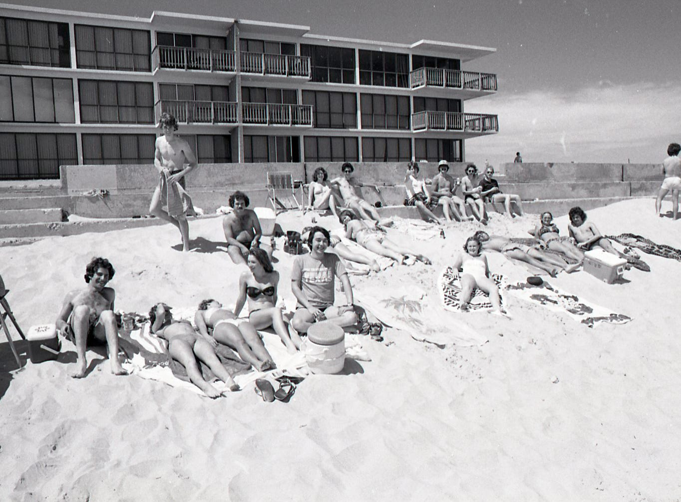 People enjoy the beach in front of the Padre Island seawall during spring break on March 18, 1978.