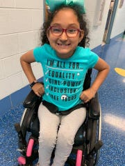 Sarah Flores, 9, has spent recess separate from her friends and classmates. Born with spina bifida, the nine-year-old uses a wheelchair at school which restricts her access to the school's playground. Bumpy mulch would get caught in the wheels, and pieces of black weed barrier have broken through the mulch creating a trip hazard.
