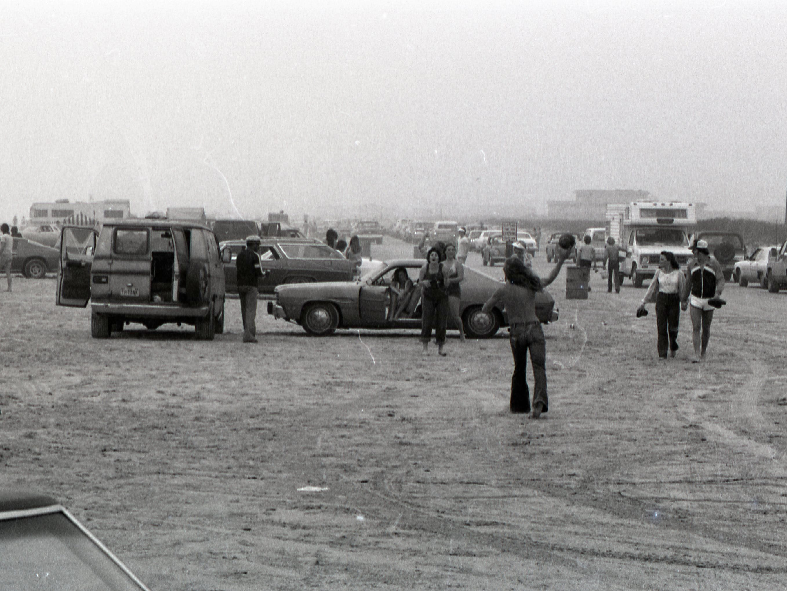 People enjoy the beach on Padre and Mustang islands during spring break on March 17, 1979.