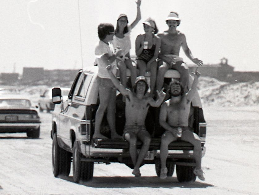 A truck full of spring breakers cruise down Padre Island on March 18, 1978.