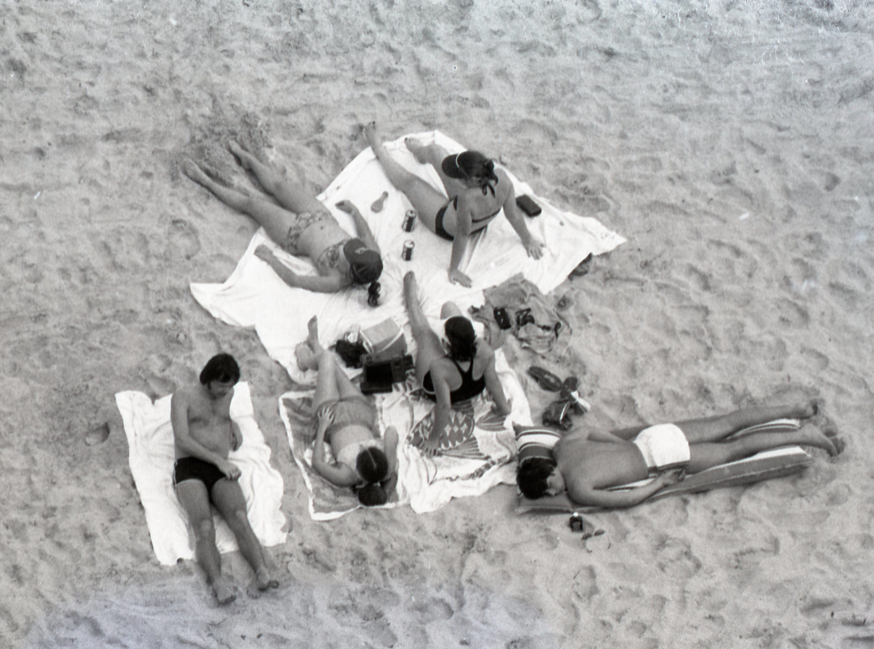 A group lounges on the beach on Padre Island during spring break March 17, 1979.