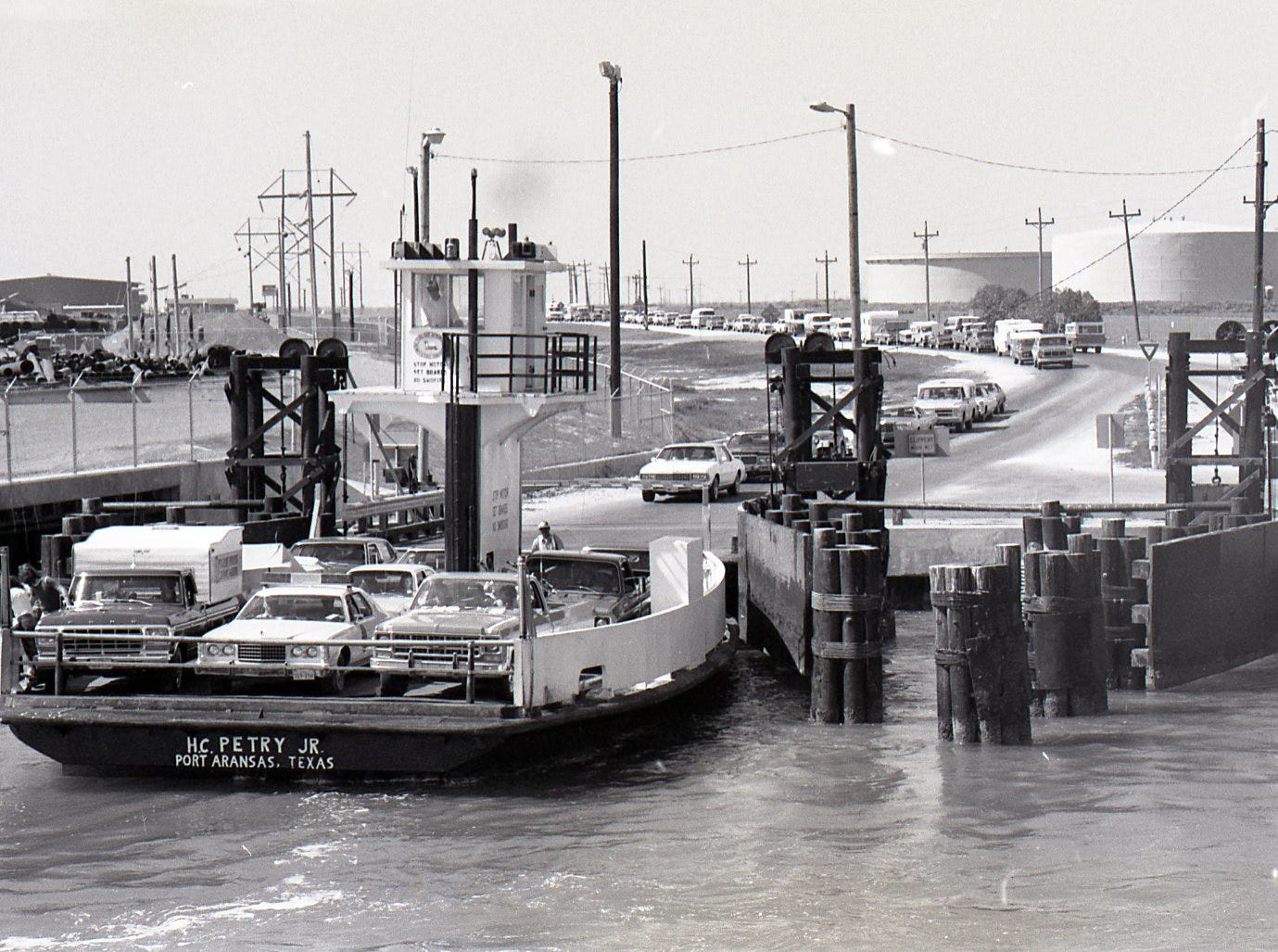 Cars wait for the ferry in Port Aransas during spring break on March 18, 1978.