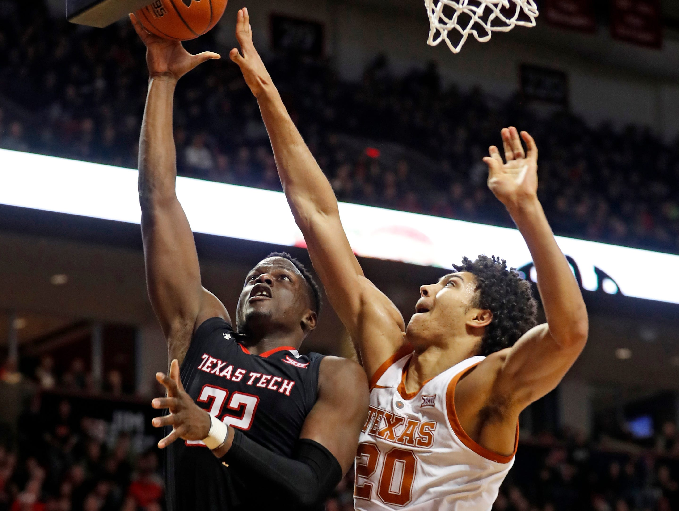 Texas Tech's Norense Odiase (32) shoots the ball over Texas' Jericho Sims (20) during the second half of an NCAA college basketball game, Monday, March 4, 2019, in Lubbock, Texas. (AP Photo/Brad Tollefson)