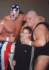 King Kong Bundy (right) and Patriot take a photo with a fan during a 2000 pro wrestling event in Barnegat.