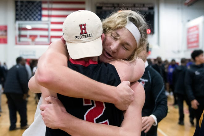 Haddonfield's Dylan Heine, right, is embraced following a 69-67 win in a South Jersey Group 2 final against Camden Monday, March 4, 2019 at Cherry Hill East High School in Cherry Hill, N.J.