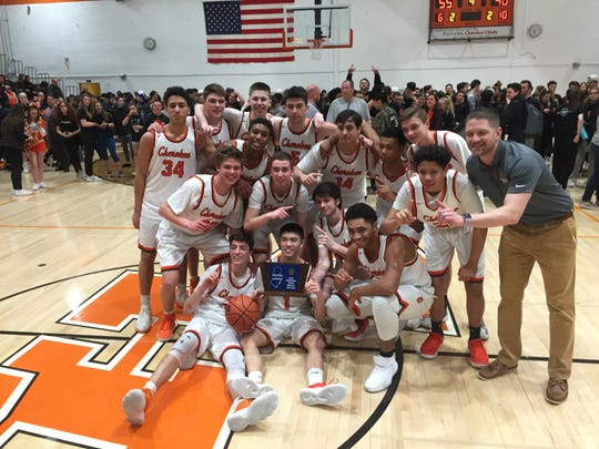 The Cherokee High School boys' basketball team celebrates its first South Jersey Group 4 title in nine years after a 55-40 win over visiting Millville.