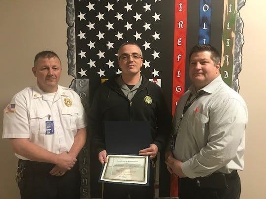 Chillicothe Correctional Officer Justin Fout, center, poses with his Officer of the Year award with CCI Warden Tim Shoop, right, and Major Paul Arledge.