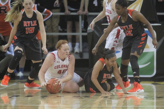 Ryle and Dixie Heights battle for the loose ball in the 2019 9th Region final