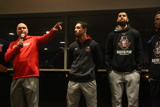 Austin Peay coach Matt Figger (left) points to the crowd as he talks about his team's chances in the OVC Tournament that begins for the Govs Thursday in Evansville, Ind.