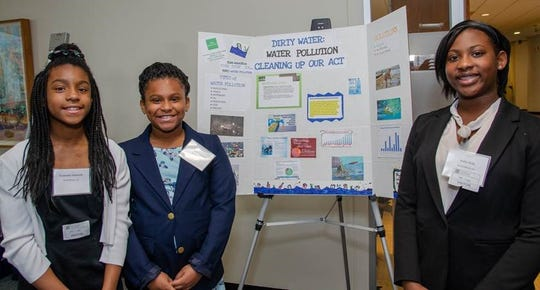 New Jersey Youth Team AquaTech, Kaila Dula of Plainfield,  Ifayola Adewole and Folesade Adewole of North Plainfield,  earns 1st place honors at the 2019 Global Economic Symposium at the  Boston Federal Reserve.