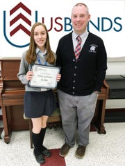 "Marching Band Director Ed Webber (shown with Emily) stated that ""Emily is a fantastic student. Her efforts in music are representative of her character. She epitomizes the best that Immaculata has to offer, hardworking, well-liked by her peers, and always willing to help others. We are thrilled that she received such an honor by USBands."""