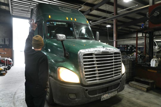 Service Manager Joe Lawrence guides a truck into a bay at Precision Truck Solutions in Fresno. Precision recently purchased Mason Trucking and is consolidating both operations in the former Mason's building.