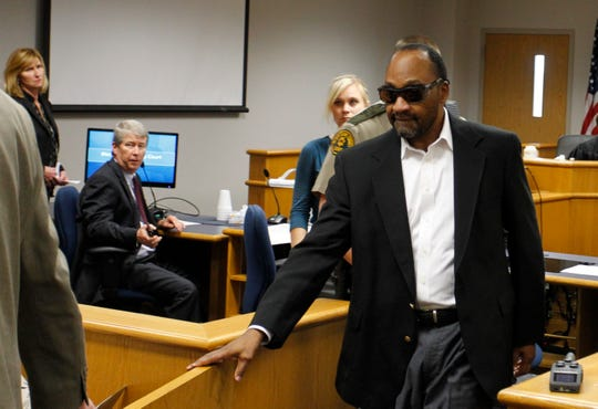 In this Sept. 24, 2018 photo, Stanley Liggins leaves a Black Hawk County courtroom after a judge declared a mistrial when jurors were unable to reach a verdict in his murder trial in Waterloo. An attorney for Liggins says he has discovered records showing that prosecution witness Antonio Holmes was given a favorable plea agreement in exchange for his testimony against Liggins. Liggins is preparing to stand trial a fourth time in the death of 9-year-old Jennifer Lewis.