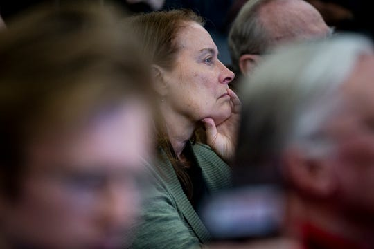 A woman in the crowd listens to Washington Gov. Jay Inslee, who announced his candidacy for president on March 1, while he speaks on the Iowa State University campus on Tuesday, March 5, 2019, in Ames, Iowa.