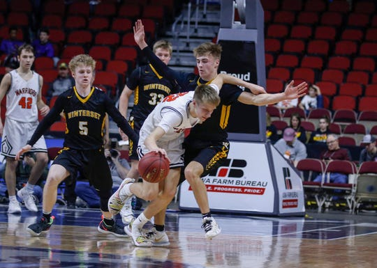 Sergeant Bluff-Luton sophomore Jake Layman tries to find a way inside late in the second quarter against Winterset in their Class 3A quarterfinal game during the 2019 Iowa high school boys state basketball tournament at Wells Fargo Arena in Des Moines.