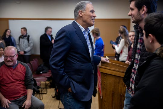 Washington Gov. Jay Inslee, who announced his candidacy for president on March 1, talks with students on the Iowa State University campus on Tuesday, March 5, 2019, in Ames, Iowa.