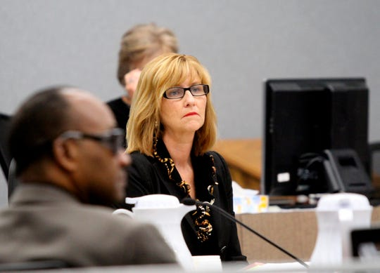 In this Sept. 6, 2018 photo, Assistant Scott County Attorney Julie Walton listens to testimony during the trial of Stanley Liggins, left, in Waterloo, Iowa. An attorney for Liggins says he has discovered records showing that prosecution witness Antonio Holmes was given a favorable plea agreement in exchange for his testimony against Liggins even though Holmes insisted at each trial that prosecutors did not give him any benefit in exchange for his testimony. Liggins is preparing to stand trial a fourth time in the death of 9-year-old Jennifer Lewis.