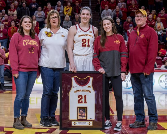 Iowa State's Bridget Carleton celebrates with her family and teammates on the Cyclones' Senior Night, Monday. Carleton led the Cyclones to a 69-49 win over Kansas with 20 points, 11 rebounds, 4 steals and 3 assists.