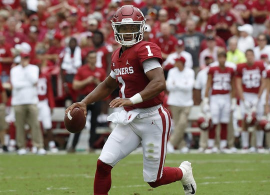 Oklahoma quarterback Kyler Murray looks downfield for a receiver against UCLA.