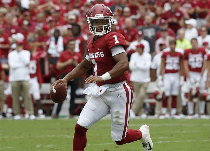 Oklahoma quarterback Kyler Murray looks downfield for a receiver against UCLA on Sept. 8, 2018 in Norman, Okla.
