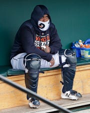 Tigers catcher Hector Sanchez bundles up in the dugout as temperatures dropped before the start of a spring training baseball game against the Toronto Blue Jays on Tuesday, March 5, 2019, in Lakeland, Fla.