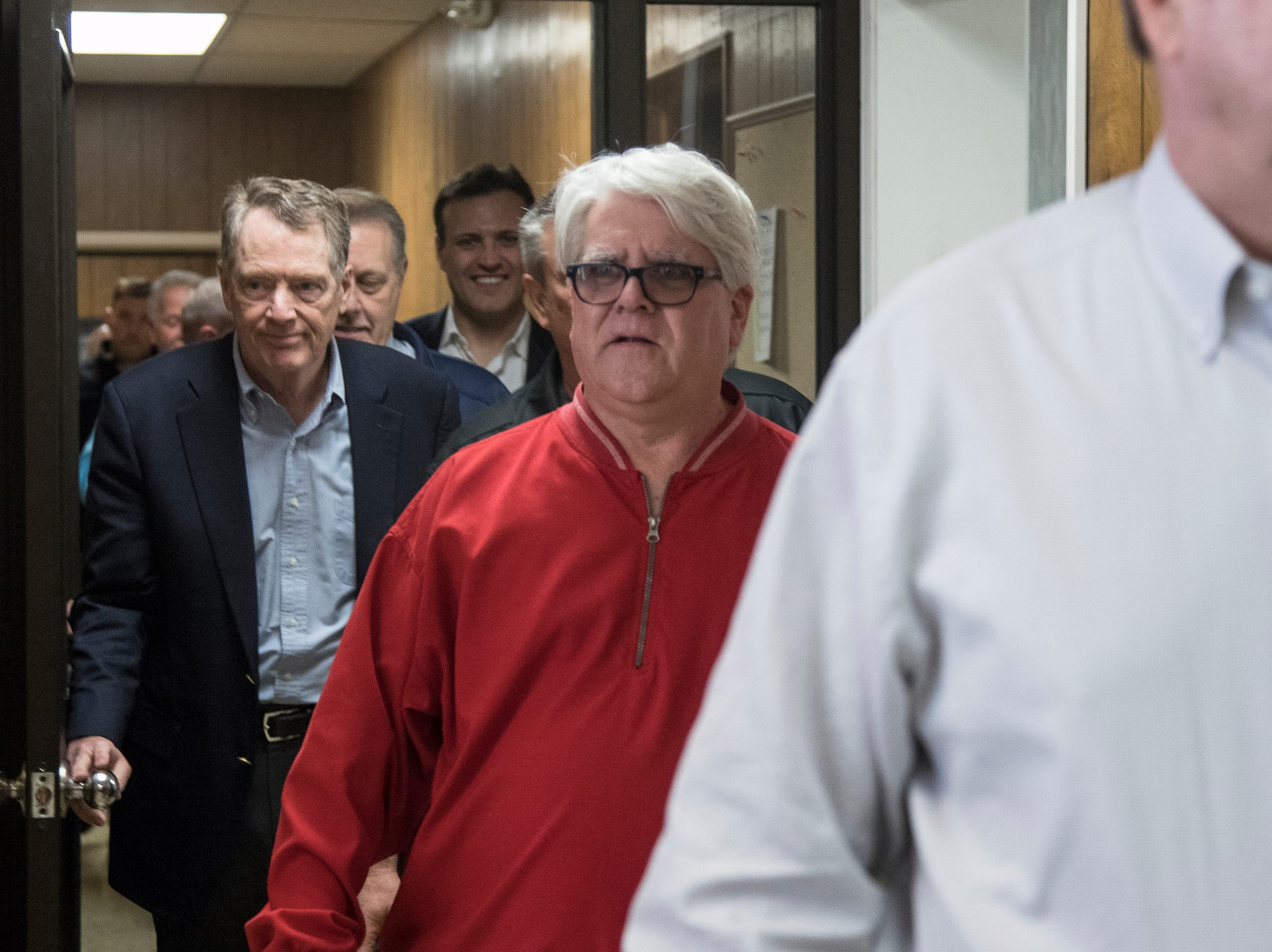 Robert Lighthizer, U.S.  trade representative, left, walks into the UAW Local 600 building in Dearborn following Bernie Ricke, UAW local 600 president, center, and Gary Jones, UAW president before the meeting, Tuesday, March 5, 2019.