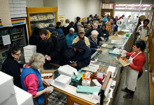 A large crowd came out to buy their paczkii at New Martha Washington Bakery in Hamtramck Tuesday morning.