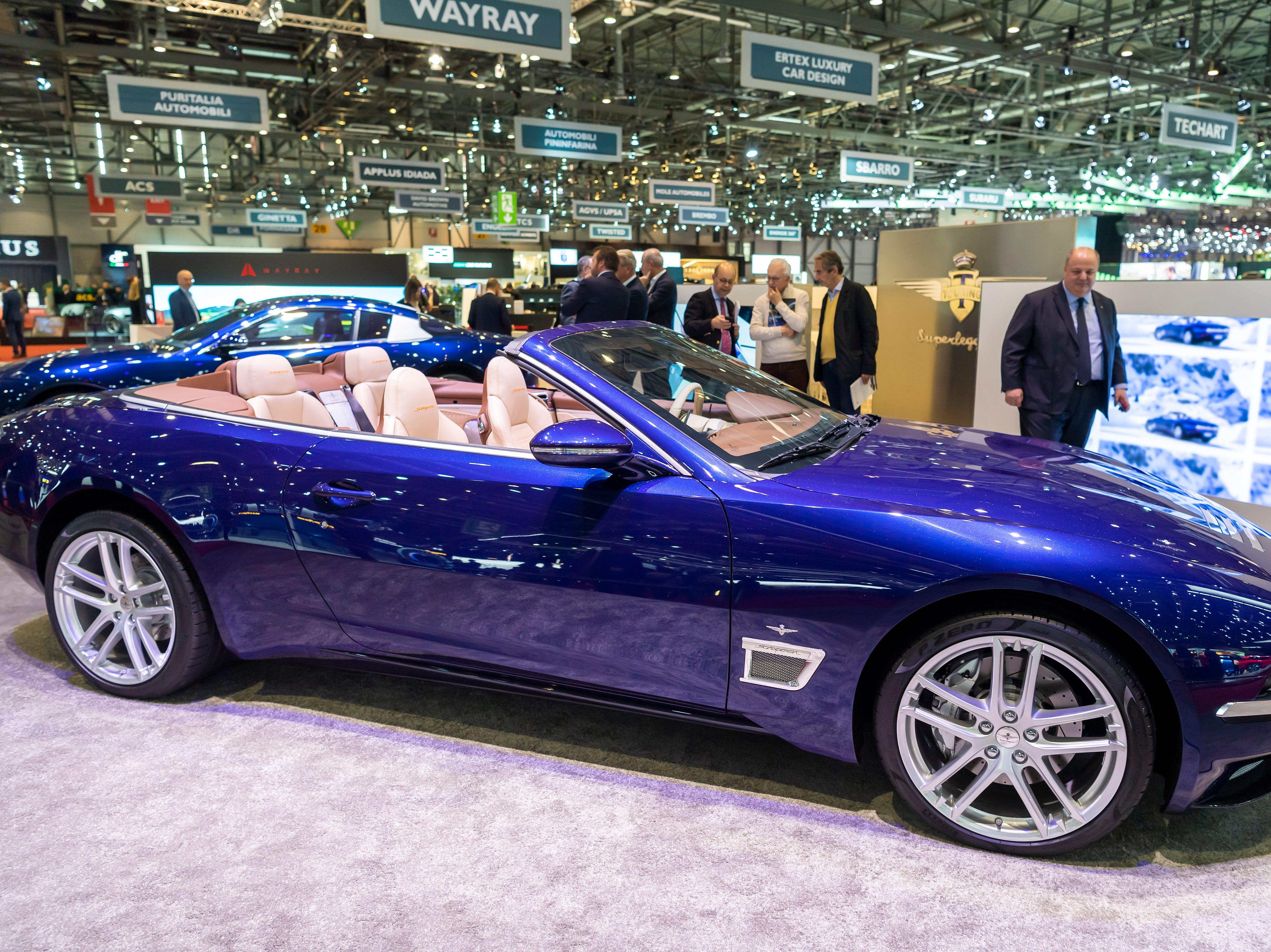 Visitors look at the new Touring Superleggera Sciadipersia cabrio.