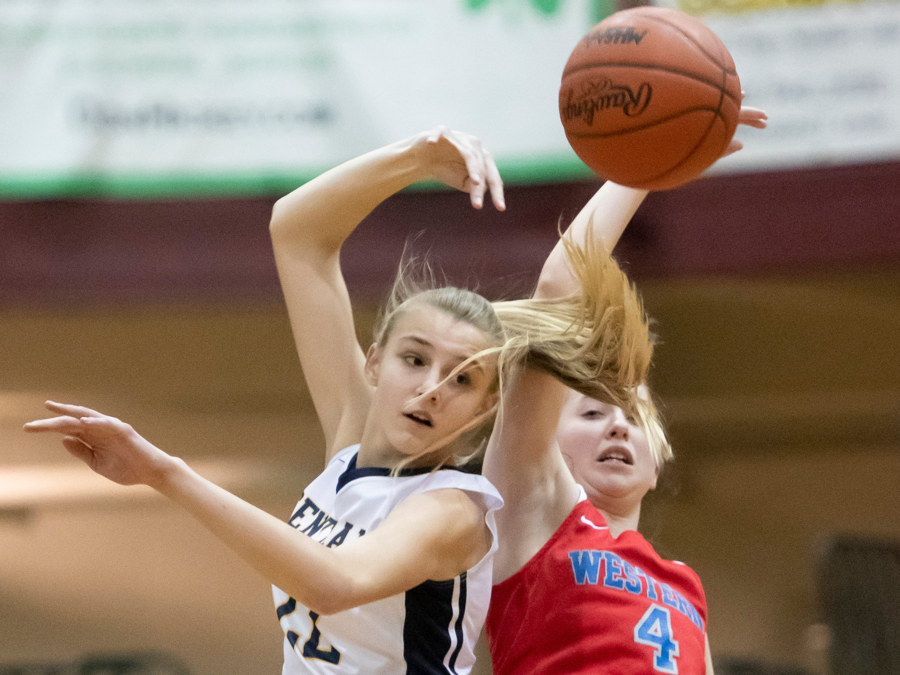 Walled Lake Central's Abbey Renner, left, and Walled Lake Western forward Jenna Galecki battle for the tip off at the beginning of the game.