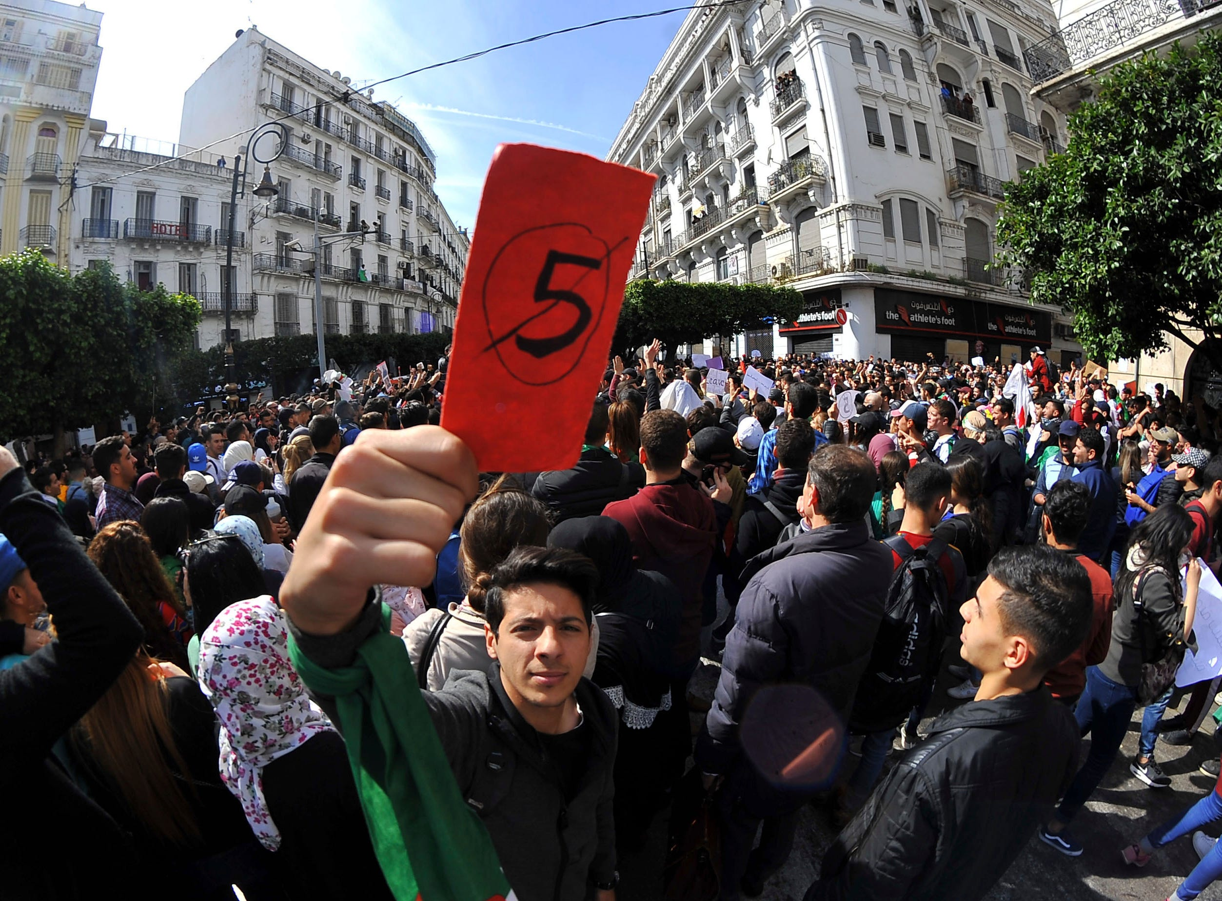 Hundreds of students gather in central Algiers to protest Algerian President Abdelaziz Bouteflika's decision to seek fifth term, Tuesday, March 5, 2019. Algerian students are gathering for new protests and are calling for a general strike if he doesn't meet their demands this week.