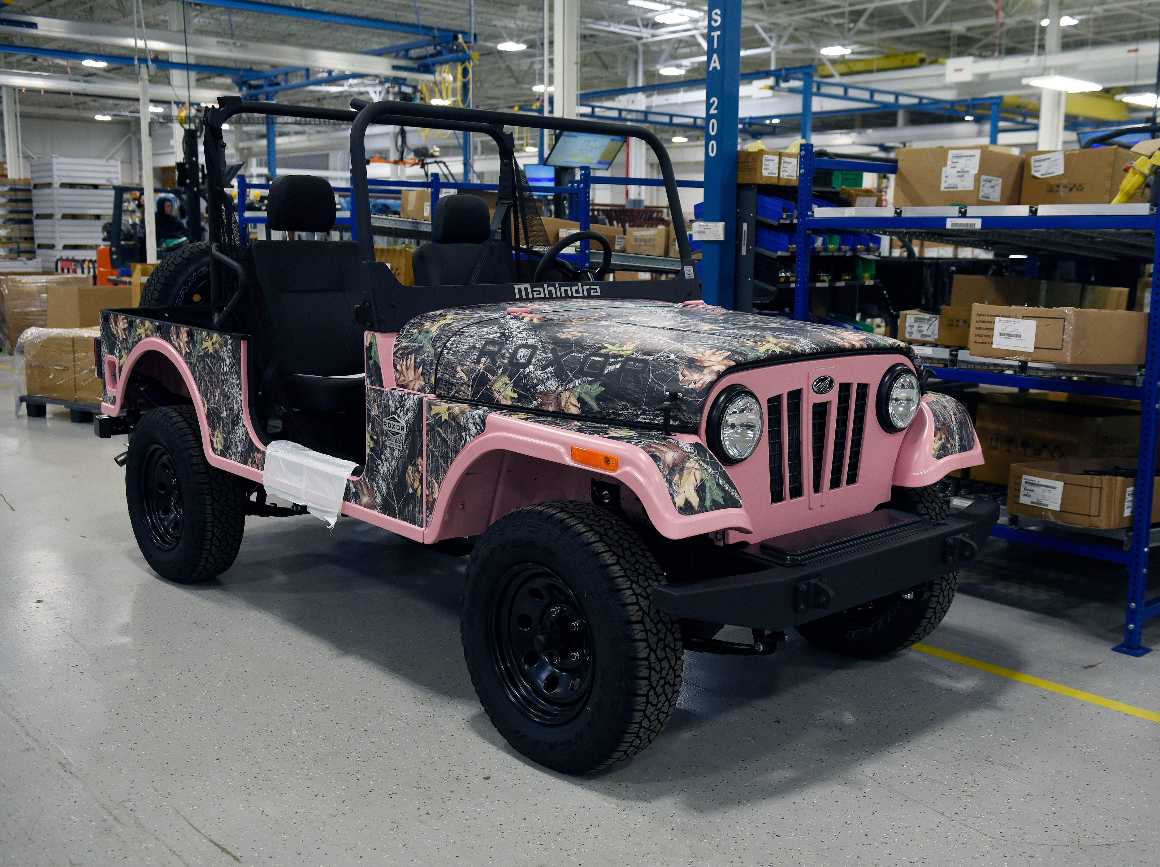 A pink 2019 Roxor with a  camouflage wrap design. Roxor offers more than 400 custom color wraps.