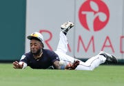 Tigers center fielder Niko Goodrum dives but can't make a catch on a base hit by the Blue Jays' Danny Jansen in the second inning of a spring-training game Tuesday in Lakeland, Fla.