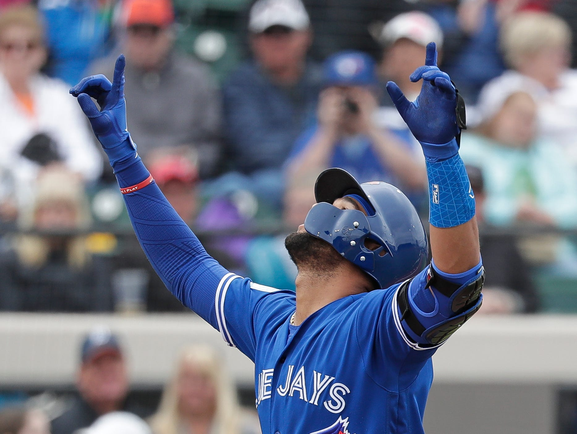 Toronto Blue Jays' Lourdes Gurriel Jr. points upward as he crosses the plate after hitting a home run against the Detroit Tigers in the fourth inning of a spring training baseball game.