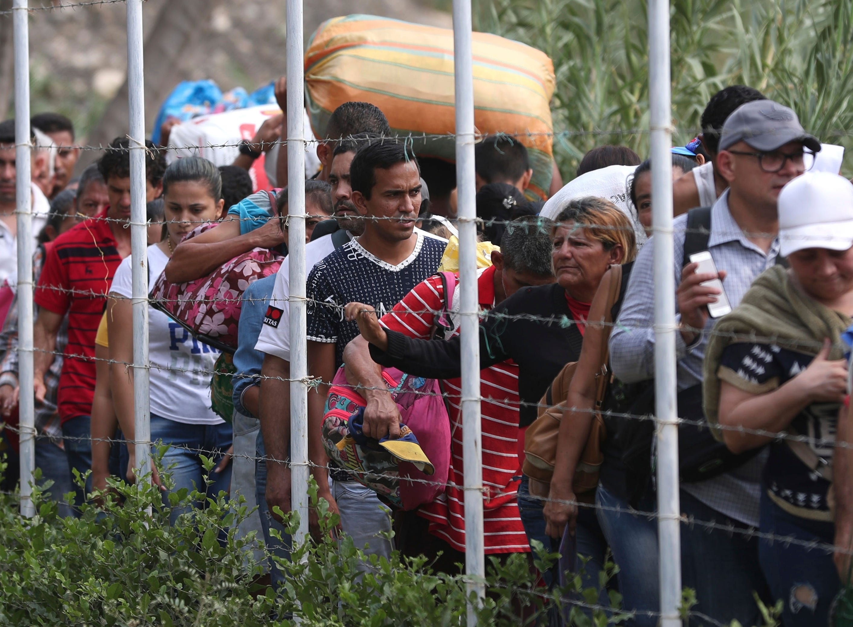 Venezuelans cross illegally into Colombia near the Simon Bolivar International Bridge, which Venezuelan authorities continue to keep closed, as soldiers start blocking some of the illegal crossings as well, in La Parada near Cucuta, Tuesday, March 5, 2019.