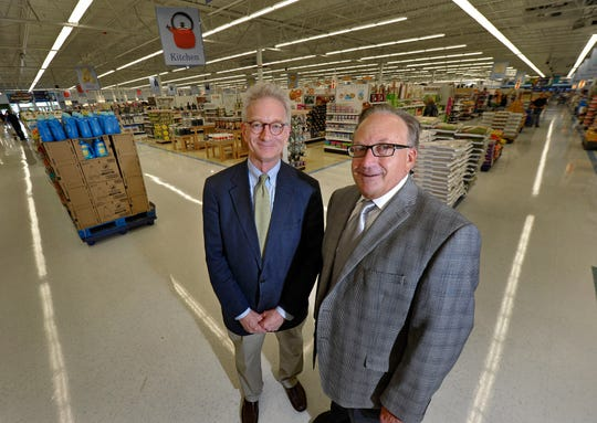 Hank, left, and Doug Meijer, took over the family-owned grocer from their father, Frederick, in 1990.