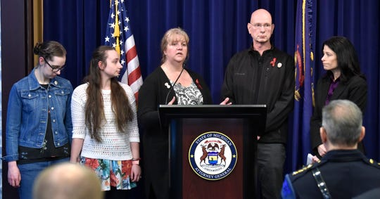 From right, Michigan Attorney General Dana Nessel listens as Danielle Stislicki's parents, Richard and Ann, address the media while Danielle's sisters, Jillian and Holly, listen during the press conference.
