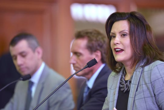 Gov. Gretchen Whitmer, right, presents her budget to Michigan lawmakers, a proposal that would increase taxes on small business even as it exempt public-sector pensions from the state income tax.